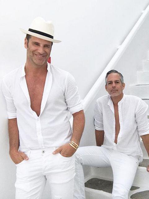Sleeve, Dress shirt, Shoulder, Collar, Hat, Joint, White, Sun hat, Muscle, Facial hair,