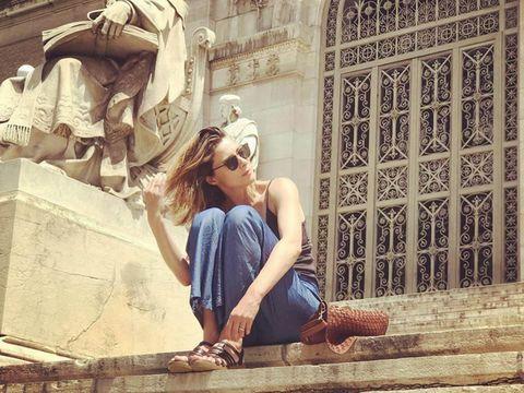 Human leg, Denim, Sunglasses, Street fashion, Temple, Goggles, Knee, Sandal, Foot, Sculpture,