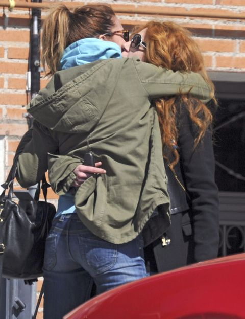 Hairstyle, Bag, Jacket, Luggage and bags, Denim, Back, Street fashion, Brown hair, Blond, Long hair,