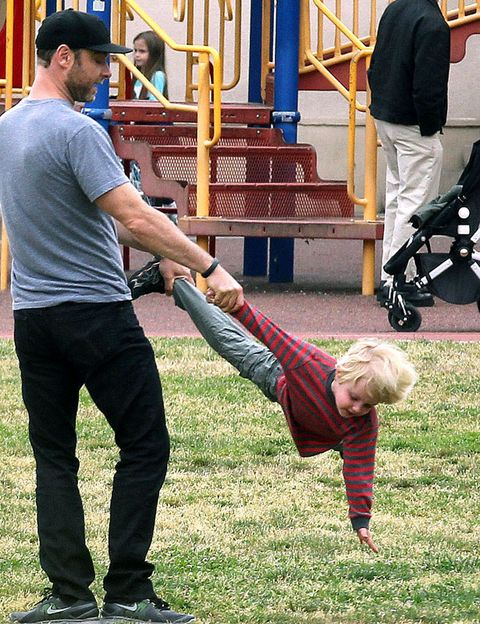 Leg, Shoe, Public space, People in nature, Toddler, Human settlement, Outdoor play equipment, Play, Playing sports, Baby,