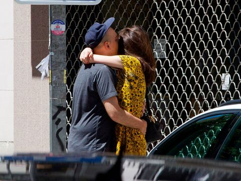 Vehicle door, Yellow, Interaction, Snapshot, Human, Photography, Window, Street fashion, Kiss, Hand,