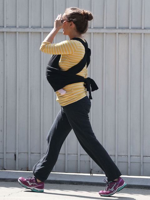 Tights, Clothing, Sportswear, Street fashion, Yellow, Standing, Waist, Trousers, Active pants, Leg,