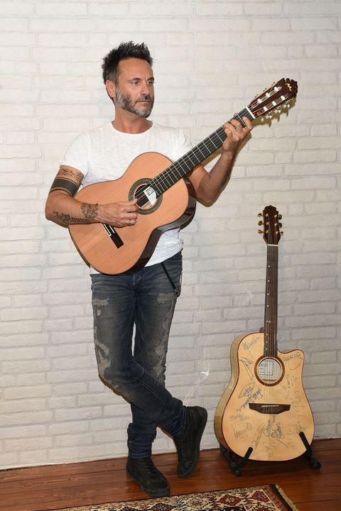 Musical instrument, String instrument, String instrument, Plucked string instruments, Guitar, Musician, Guitarist, Musical instrument accessory, Music, Jeans,