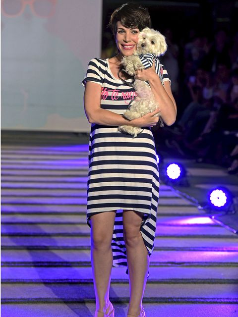 Human, Shoulder, Dress, Human leg, Style, Purple, Fashion, Fashion model, Fashion show, Carnivore,