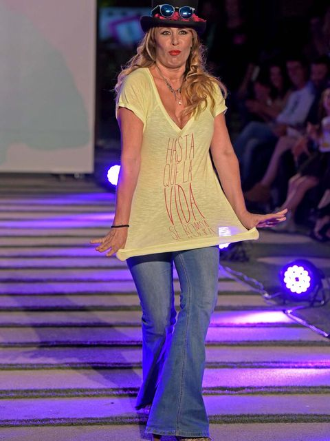 Clothing, Blue, Shoulder, Shoe, Purple, Fashion show, Joint, Outerwear, Hat, Style,