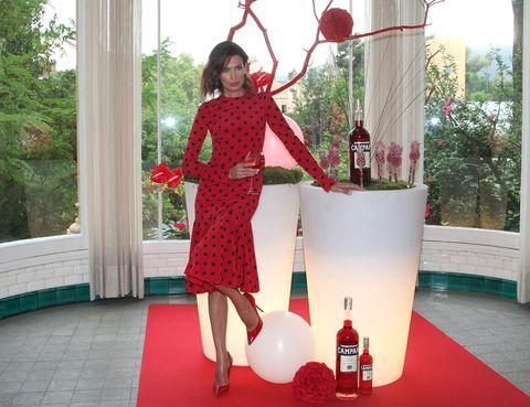 Red, Flooring, Dress, Basketball hoop, Design, Holiday, Bottle, Carpet, One-piece garment, Costume,
