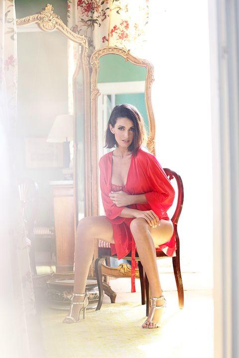 Sitting, Interior design, Knee, Thigh, Fashion model, Street fashion, High heels, Model, Fashion design, Curtain,