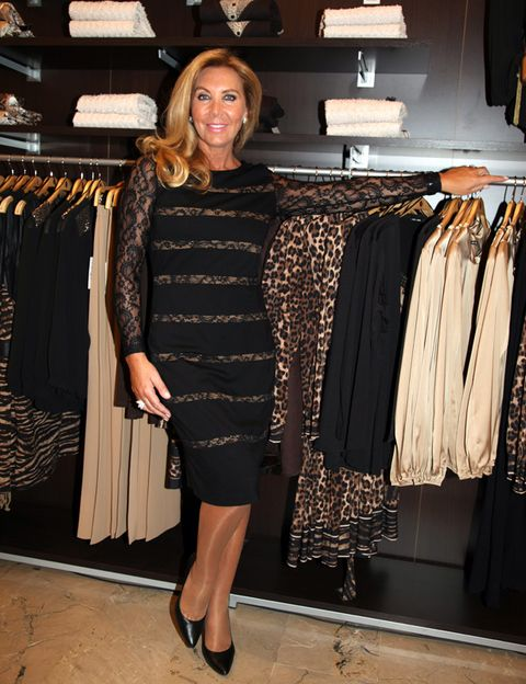 Textile, Room, Style, Clothes hanger, Fashion accessory, Fashion, Dress, Retail, Boutique, One-piece garment,