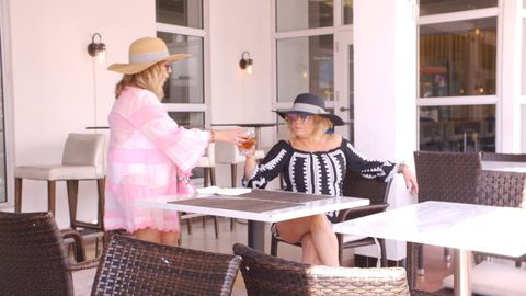 Hat, Furniture, Table, Fashion accessory, Outdoor furniture, Outdoor table, Sun hat, Wicker, Basket, Home accessories,