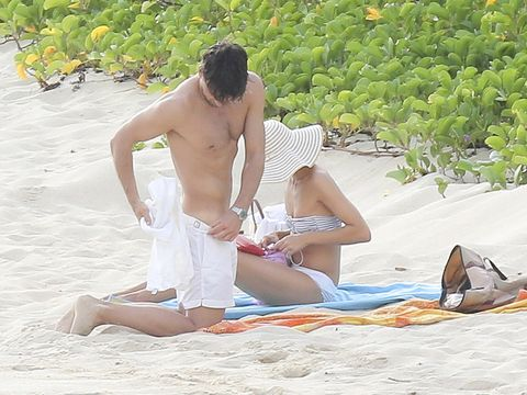 Leisure, Sitting, People in nature, Summer, Sun tanning, Shorts, Barefoot, Vacation, Sand, Barechested,