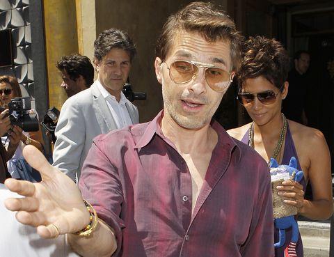 Eyewear, Arm, Vision care, Shirt, Hand, Sunglasses, Fashion accessory, Wrist, Dress shirt, Camera,