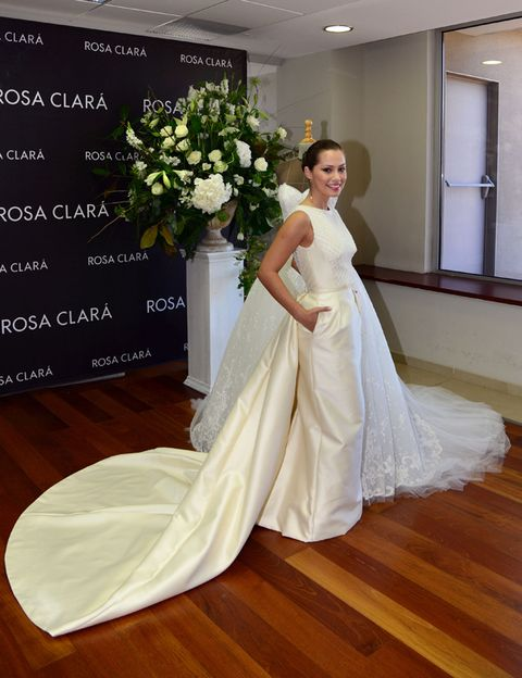 Clothing, Wood, Dress, Flooring, Floor, Shoulder, Textile, Bridal clothing, Hardwood, Petal,