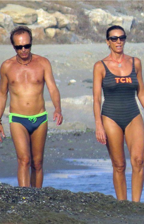 Clothing, Eyewear, Leg, Human body, Sunglasses, Goggles, Chest, Summer, Swimwear, Leotard,