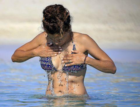 Body of water, Human body, Brassiere, Shoulder, Water, Swimwear, Chest, Summer, Swimsuit top, Liquid,