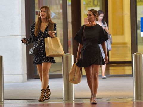 Dress, Human body, Shoulder, Human leg, Style, Beauty, Waist, Fashion, One-piece garment, Bag,