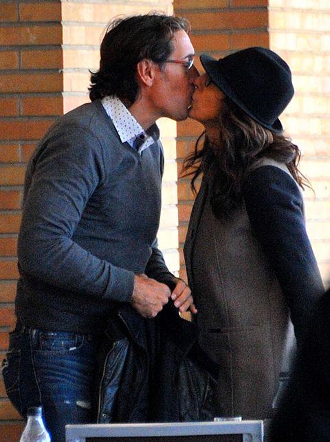 Ear, Kiss, Hat, Romance, Love, Interaction, Denim, Honeymoon, Conversation, Gesture,