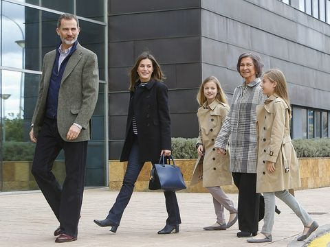 Clothing, Footwear, Coat, Leg, Brown, Trousers, Shirt, Textile, Standing, Outerwear,