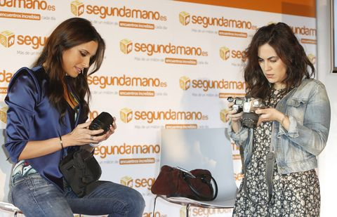 Arm, Human body, Denim, Jeans, Hand, Bag, Sitting, Camera, Luggage and bags, Fashion accessory,