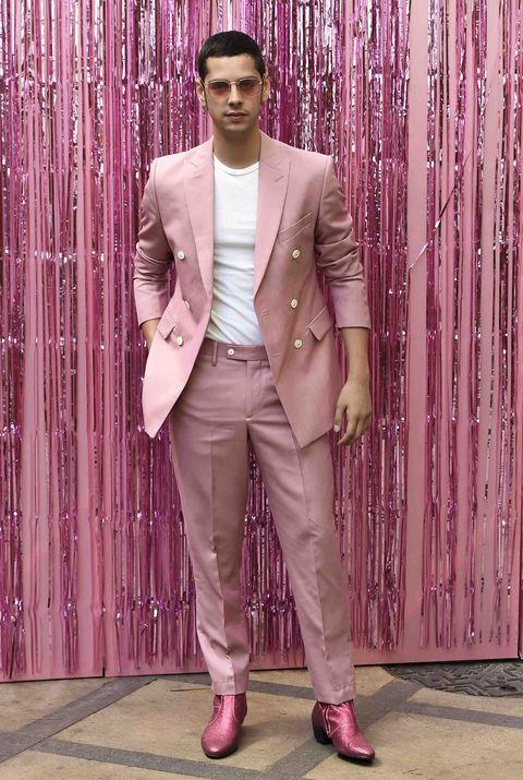 Pink, Suit, Clothing, Formal wear, Blazer, Fashion, Outerwear, Tuxedo, Pantsuit, Magenta,