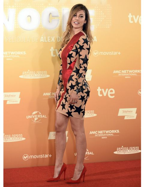 Dress, Shoe, Human leg, Shoulder, High heels, Orange, Style, Flooring, Fashion model, One-piece garment,