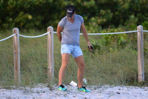 Human leg, Summer, Shorts, Athletic shoe, Sneakers, Active shorts, Calf, Sunglasses, Goggles, Fence,