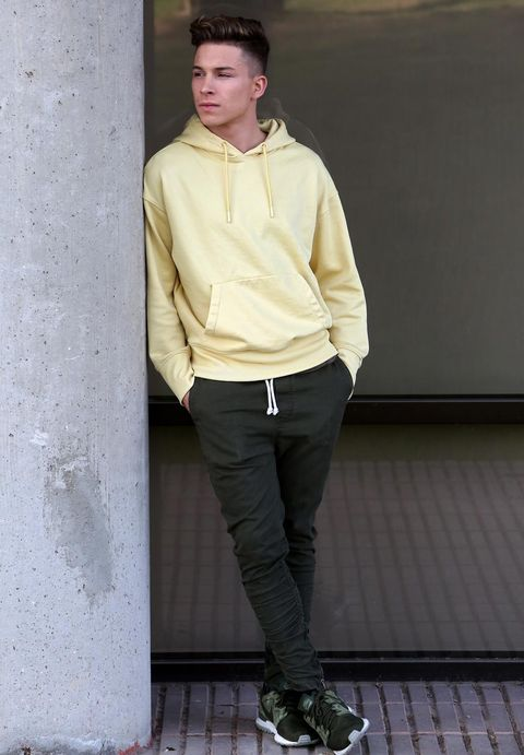Clothing, White, Fashion, Footwear, Jeans, Street fashion, Yellow, Khaki, Standing, Snapshot,