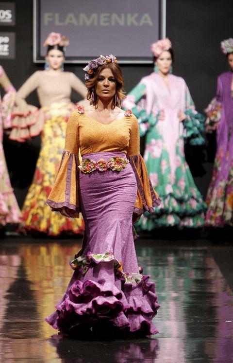 Formal wear, Fashion show, Gown, Fashion accessory, Purple, Beauty, Fashion, Costume design, Performance, Fashion model,