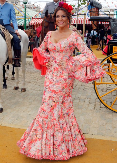 Textile, Dress, Pink, Umbrella, Gown, Fashion, Temple, One-piece garment, Costume, Tradition,