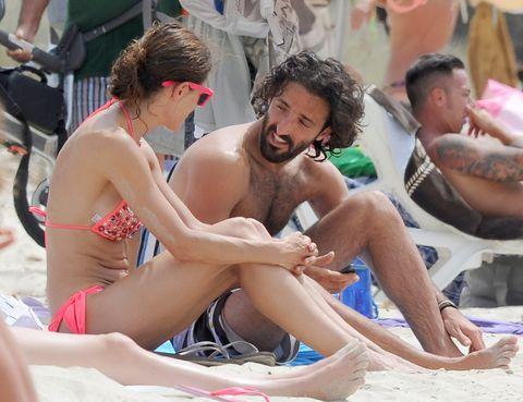 Leg, Fun, Human leg, Sitting, Summer, Toe, Brassiere, Sun tanning, Barefoot, Thigh,