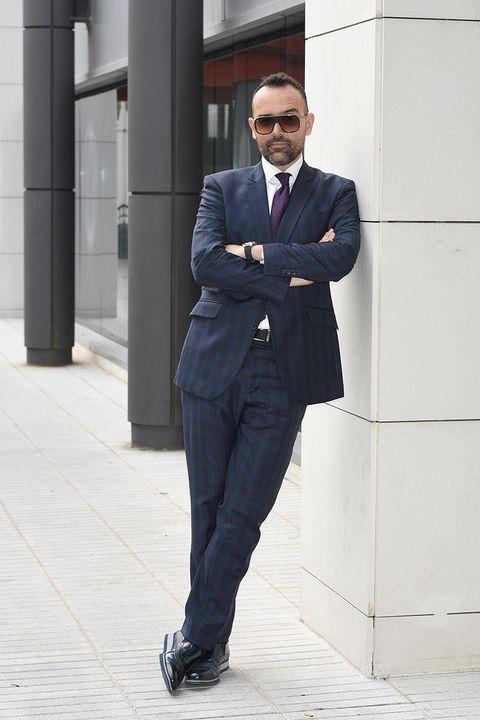 Suit, Clothing, Street fashion, Standing, Formal wear, Fashion, Outerwear, Blazer, White-collar worker, Footwear,