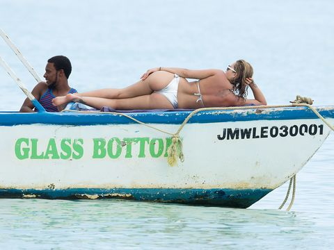 Water transportation, Vacation, Vehicle, Bikini, Boat, Swimwear, Boating, Fun, Sun tanning, Recreation,
