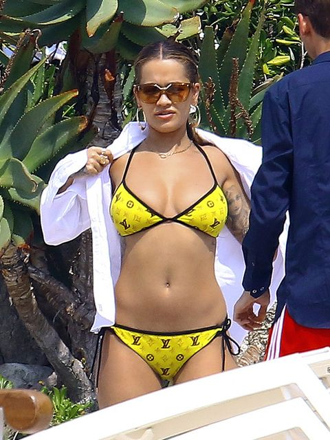 Bikini, Undergarment, Clothing, Swimwear, Lingerie, Swimsuit bottom, Navel, Swimsuit top, Yellow, Stomach,