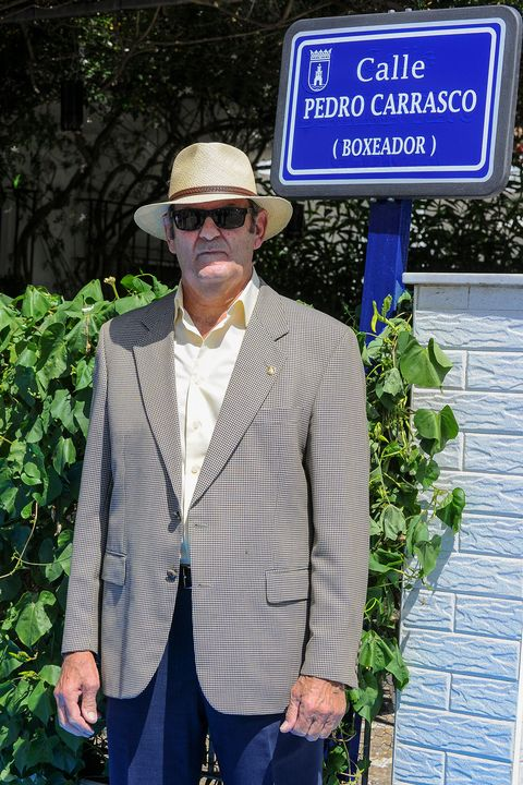 Suit, Outerwear, Blazer, Hat, Jacket, Headgear, Formal wear, Plant, Photography, Signage,
