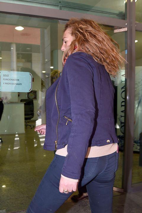 Clothing, Purple, Standing, Jeans, Shoulder, Outerwear, Waist, Jacket, Blazer, Brown hair,