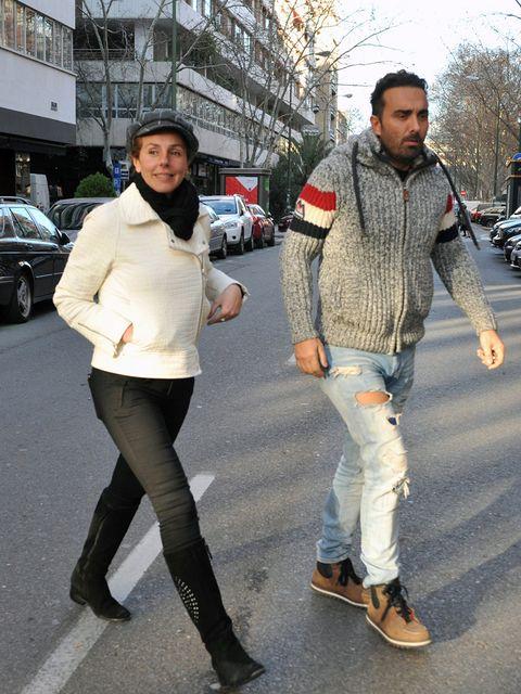 Clothing, Footwear, Leg, Land vehicle, Trousers, Road, Street, Shirt, Textile, Outerwear,