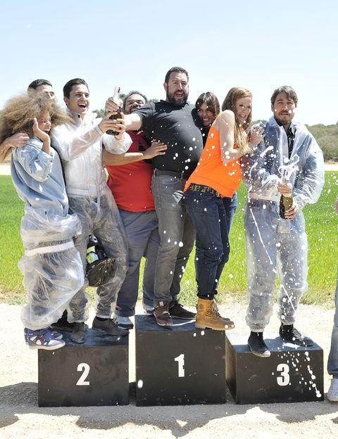 Footwear, Social group, Jeans, People in nature, Jacket, Team, Crew, Outdoor shoe, Active pants, sweatpant,