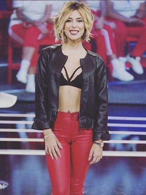 Clothing, Leather, Fashion model, Fashion, Leather jacket, Jacket, Textile, Blond, Long hair, Fashion show,