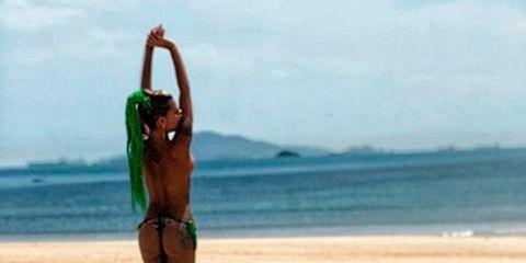 Coastal and oceanic landforms, Sand, Summer, Fluid, Beach, Elbow, Vacation, Undergarment, Holiday, Waist,