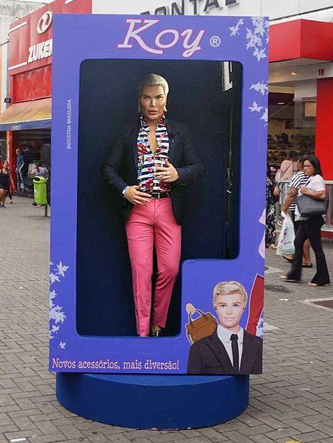 Jeans, Advertising, Street fashion, Poster, Banner, Signage, Pedestrian, Tie, Handbag,