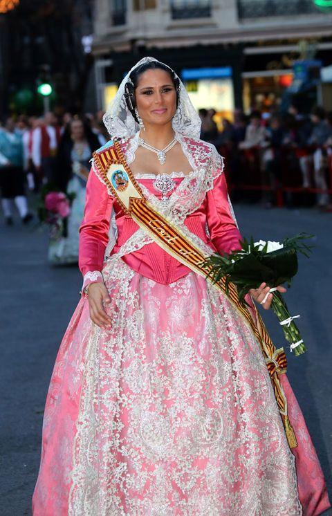 Tradition, Formal wear, Headgear, Dress, Fashion, Bridal clothing, Gown, Headpiece, Bride, Wedding dress,