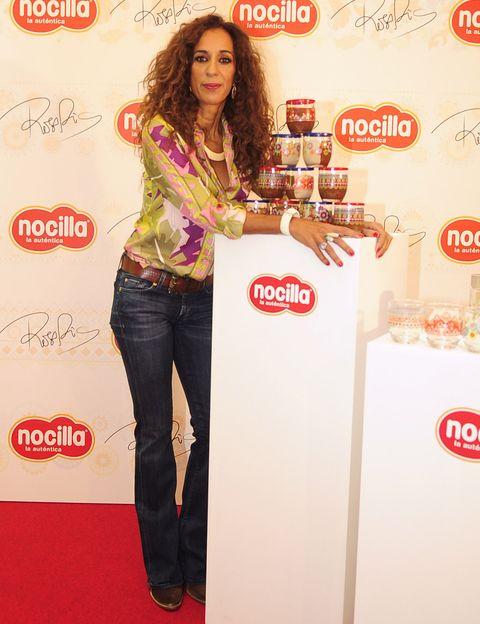 Jeans, Denim, Red, Style, Logo, Advertising, Waist, Long hair, Brown hair, Ringlet,