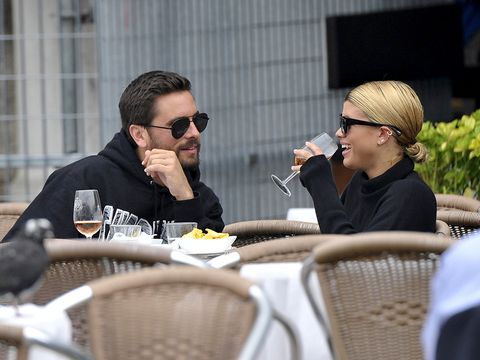 Eyewear, Conversation, Event, Interaction, Arm, Human, Table, Sitting, Sunglasses, Recreation,