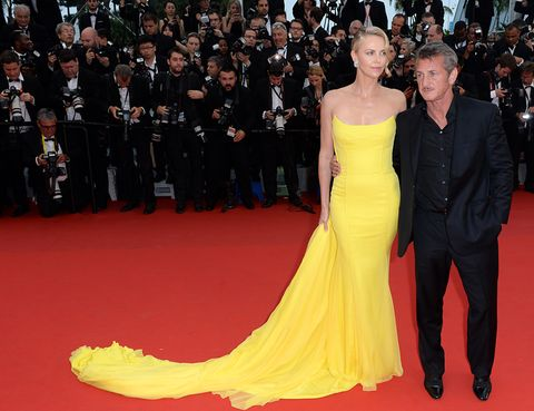 Flooring, Yellow, Event, Trousers, Dress, Coat, Carpet, Red, Outerwear, Suit,