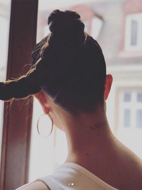 Ear, Hairstyle, Shoulder, Style, Back, Black hair, Temple, Neck, Bun, Earrings,
