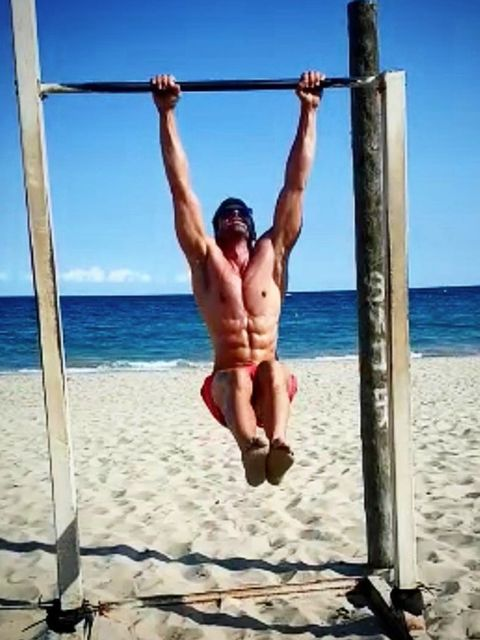 Pull-up, Muscle, Barechested, Calisthenics, Physical fitness, Horizontal bar, Leg, Vacation, Swim brief, Leisure,