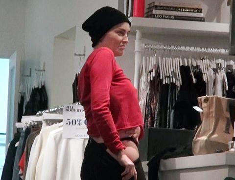Room, Textile, Clothes hanger, Headgear, Fashion, Retail, Boutique, Outlet store, Fashion design, Vintage clothing,