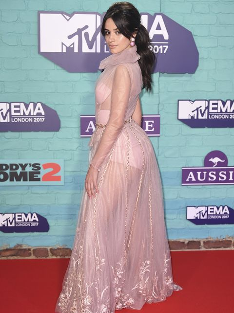 Red carpet, Dress, Clothing, Shoulder, Carpet, Hairstyle, Premiere, Gown, Flooring, Joint,