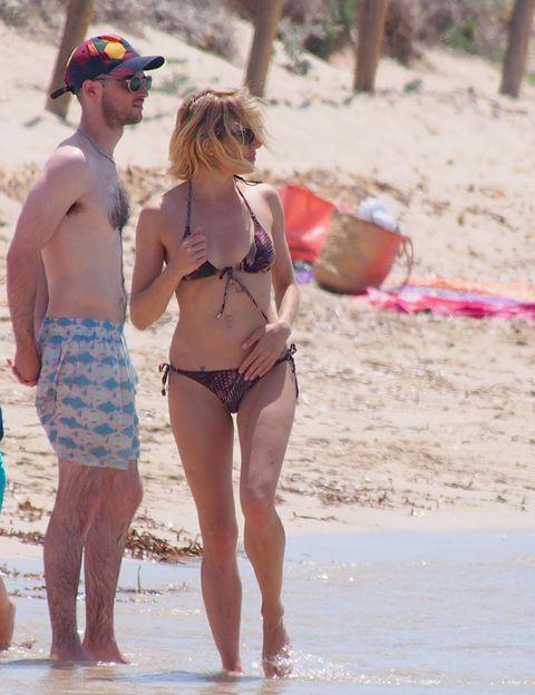Leg, Brassiere, Human body, Hat, People on beach, Summer, Undergarment, Goggles, Sunglasses, Swimsuit top,