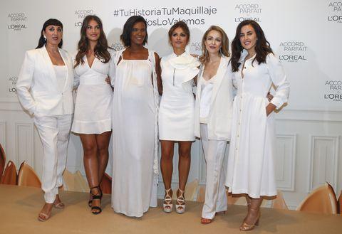 White, Uniform, Skin, Fashion, White coat, Event, Fashion design, Dress, Smile, Team,