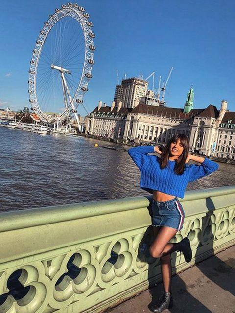 Clothing, Ferris wheel, Leg, Sky, Human body, Tourism, Human leg, Photograph, Landmark, Metropolis,